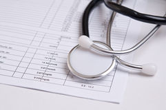 Black stethoscope on a medical analysis Royalty Free Stock Images