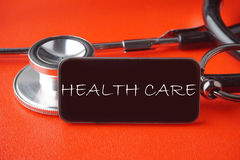 Black Stethoscope on red background Stock Image