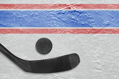 Black stick and puck on the ice Stock Photo