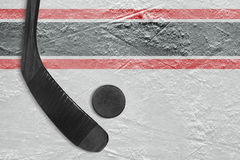 Black stick and puck on the ice. Hockey rink. Concept, background royalty free stock photos