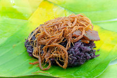 Black sticky rice with fried pork. Covered with banana leaf Stock Photography