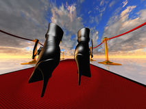 Black stilettos on red carpet Stock Photography