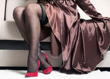 Black stockings on a woman's legs Royalty Free Stock Image