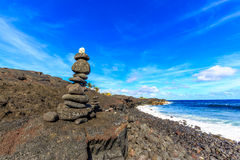 Black Stone Cairn. (ahu) at Kaimu beach park, Big Island, Hawaii Stock Photography