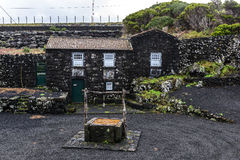 Black stone house, Azores archipelago (Portugal) Stock Images