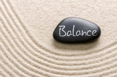 Black stone with the inscription Balance Stock Image