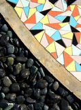 Black Stone and scattered colorful tile Stock Photography