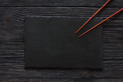 Black stone slate background texture. And chopsticks. Top view Stock Photos