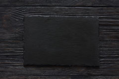 Black stone slate background texture. Top view Stock Photography