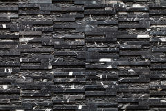 A black stone wall Stock Images