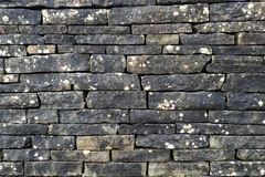 Black stone wall on a pathway in Ireland royalty free stock images