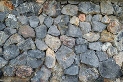 Black Stone wall texture Stock Images