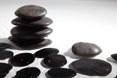Black stone with water drops Royalty Free Stock Photos