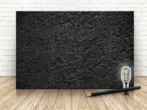 Black stone on the white  brick wall and the wood floor,template Royalty Free Stock Photo