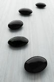 Black stone, zen spa on white wood Stock Photo