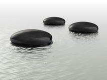 Black stones Stock Images
