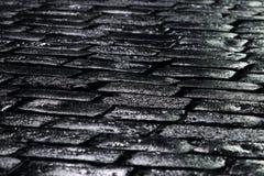 Black stones. Black road stones, rain wet. Narrow depth of field Royalty Free Stock Photo