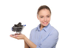 Black stones in shopping trolley on the women palm Royalty Free Stock Photo