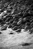 Black stones on the shore. stock photo
