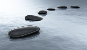 Black stones in water Stock Photography