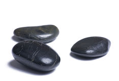 Black stones on white Royalty Free Stock Image