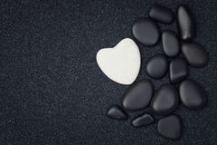 Black stones with white zen heart shaped rock Stock Photography
