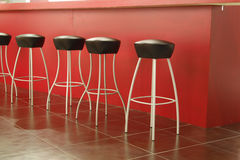 Black stool in interior of bar Stock Image