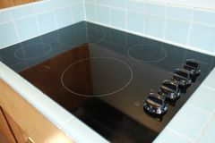 Black stove modern new countertop. Stock Photos