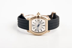 Black strap and gold watch Royalty Free Stock Photo