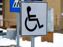 Black street sign in the parking lot. Black street sign in the parking lot for disabled persons in the busz town Royalty Free Stock Image