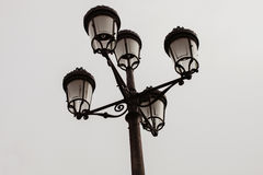 Black streetlight with five lamps Stock Image