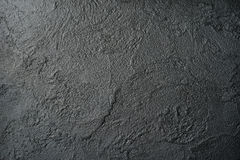 Black stucco with rich and various texture Stock Photo