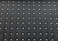 Black studded leather Stock Photos