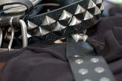 Black Studed Belt. Belt with square metal studs. Interesting position of belt and focus from soft in the foreground to sharpin the background stock images