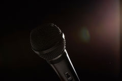 Black studio microphone on a dark background Royalty Free Stock Images