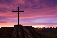Black Stump Cross. White Cross on large old tree stump at sunrise Royalty Free Stock Photos