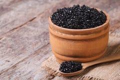 Black sturgeon caviar in a wooden a barrel Royalty Free Stock Photo