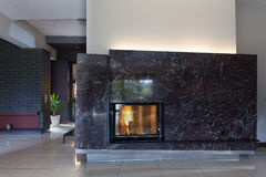Black stylish fireplace Royalty Free Stock Image