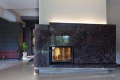 Black stylish fireplace Royalty Free Stock Image