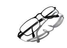 Black stylish men`s glasses. On a white background. Horizontal photo, isolated object