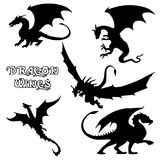 Black stylized  illustrations dragons silhouettes. Black stylized  illustrations of dragons silhouettes logo in the form of a dragon on a white background. Set Stock Images