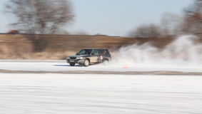 Black subaru Forester on ice track. Moscow, Russia - March 1st, 2014: Moscow Subaru Forester club championship. This stage was located in Moscow, on the frozen Royalty Free Stock Photos