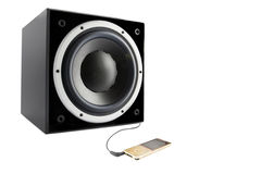Black subwoofer and mp4 player Royalty Free Stock Photography