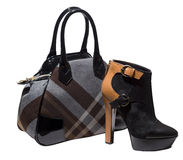 Black suede ankles and tartan bag Royalty Free Stock Photos