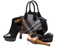 Black suede ankles and tartan bag Stock Image