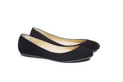 Black suede ballet flats. On a white background royalty free stock photography