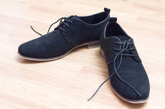 Black suede shoes with laces Royalty Free Stock Image