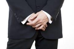 Black suit 4. Hands crossed stock photos