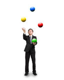 Black suit businessman juggling colorful balls Stock Photography