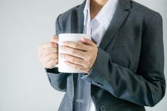 Black suit bussiness women holding a cup of coffee in break time Royalty Free Stock Images